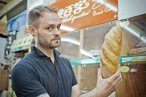 Man holding bread