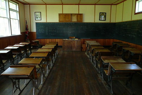 A very old school classroom with a blackboard