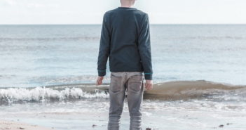 Boy looking over the sea