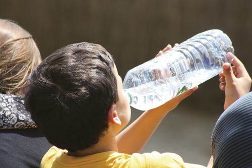 Boy drinking water from a bottle