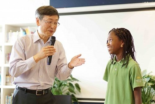 Jing Huang with a Daystar Academy student