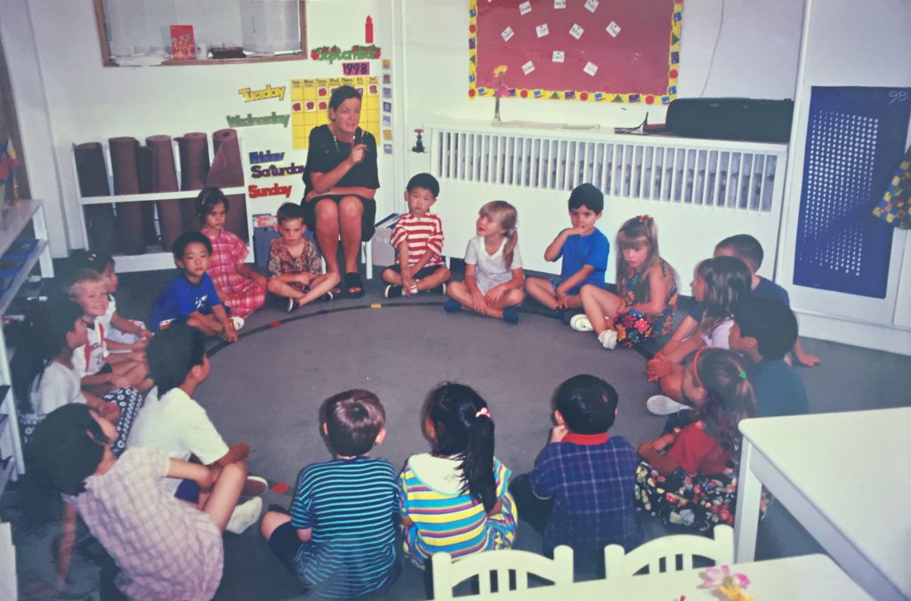 Elaine Kinlough teaches Merrideth Chen's reception class. Chen is the student closest to the white table.