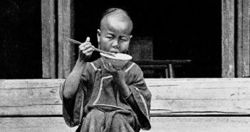 Child_Eating_Rice_with_Chopsticks