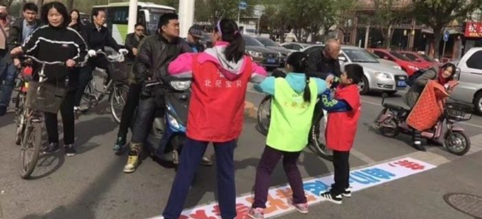 Beijing to Stop Red Light Runners by Making Children Dance in the Middle of Traffic