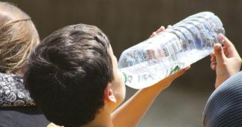 Boy drinking water from a bottle
